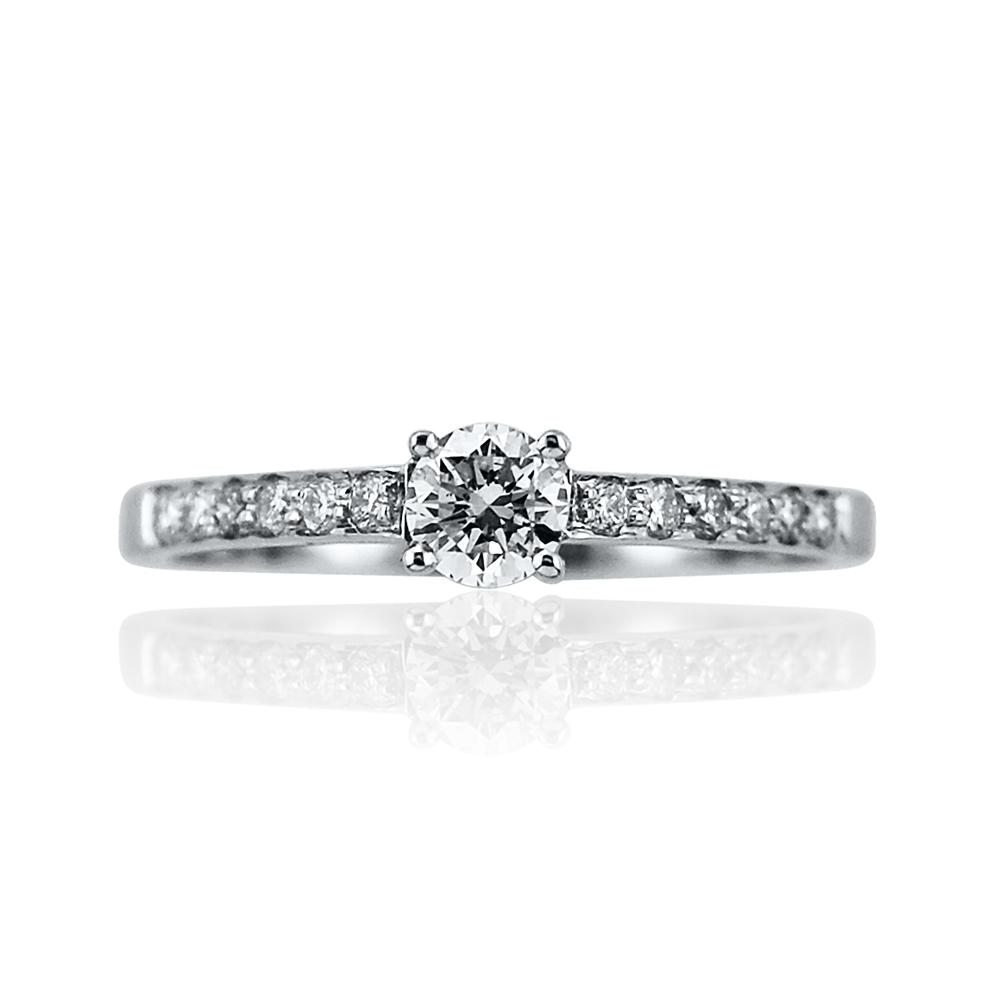 Platinum Mounted Diamond Solitaire Ring with Grain Set Diamond Shoulders