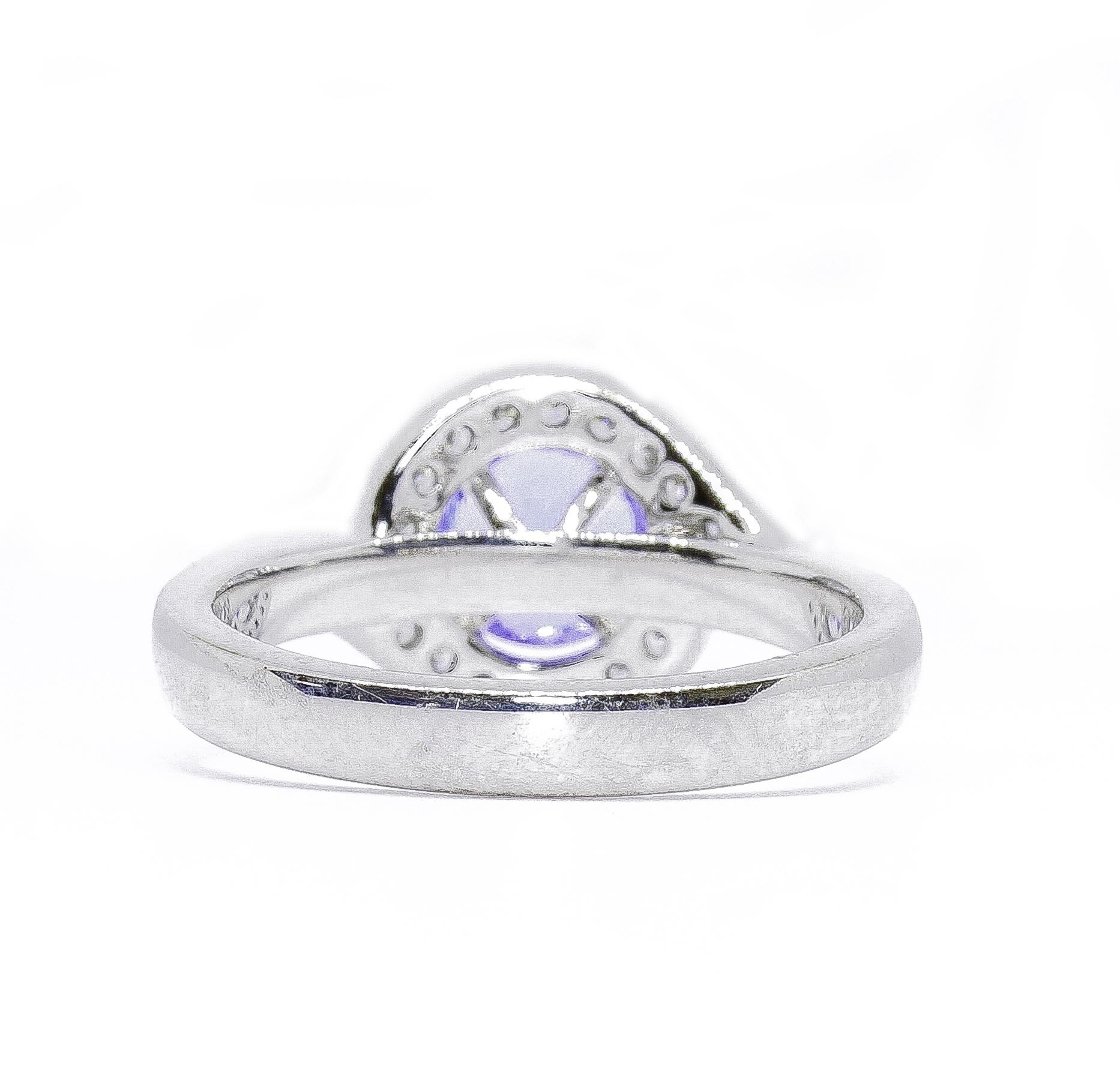 18ct White Gold Tanzanite and Diamond Crossover Design Ring